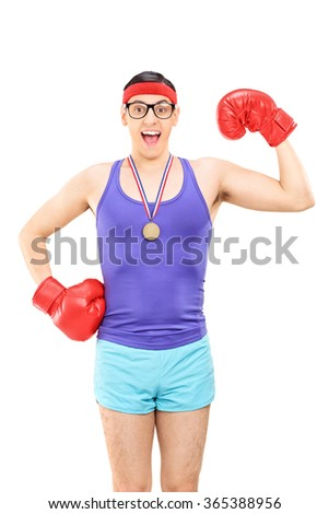 Vertical shot of a geeky guy with red boxing gloves wearing a medal isolated on white background - stock photo