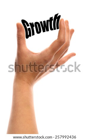 "Vertical shot of a hand squeezing the word ""Growth"" between two fingers, isolated on white. - stock photo"