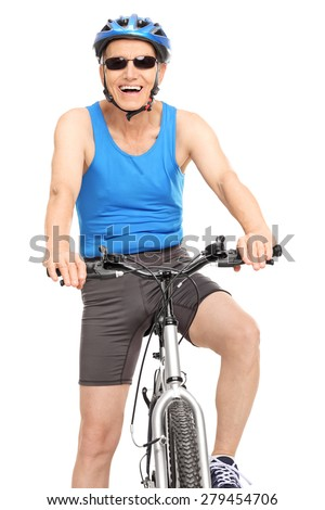 Vertical shot of a joyful senior cyclist sitting on his bike and looking at the camera isolated on white background - stock photo