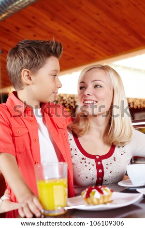Vertical shot of a lovely mother and her son enjoying sweet food - stock photo
