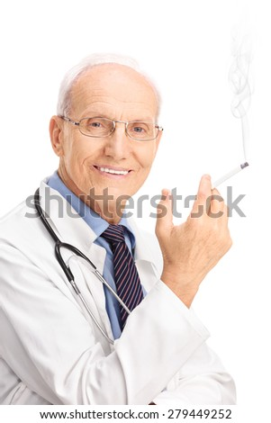 Vertical shot of a mature doctor smoking a cigarette and looking at the camera isolated on white background - stock photo