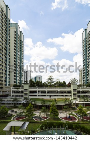 Vertical shot of a residential estate with car park and playground. - stock photo