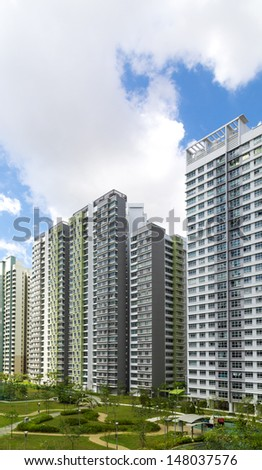 Vertical shot of a roll of Residential apartments with Park and playground - stock photo