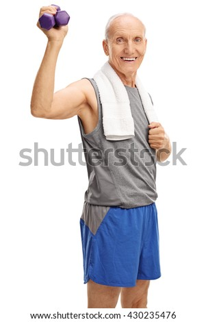 Vertical shot of a senior man in sportswear holding two purple dumbbells isolated on white background - stock photo