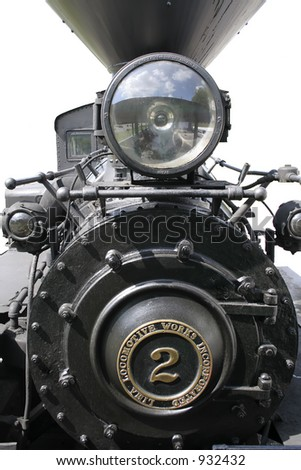 Vertical shot of a steam engine. Isolated over white - put it over or blend into any background you want