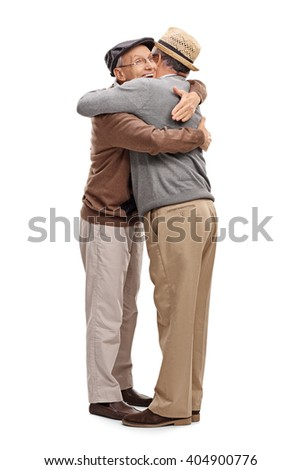 Vertical shot of a two old friends hugging each other isolated on white background