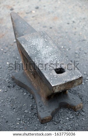 Vertical shot of a vintage anvil, close-up - stock photo