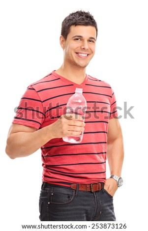 Vertical shot of a young man drinking water from a bottle isolated on white background  - stock photo