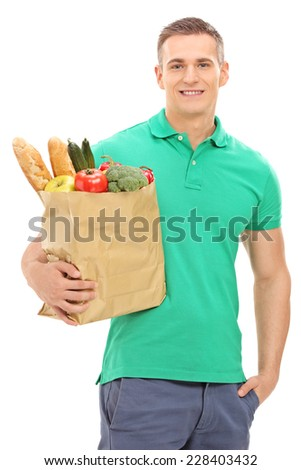Vertical shot of a young man holding a grocery bag isolated on white background