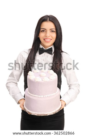 Vertical shot of a young waitress carrying a birthday cake isolated on white background - stock photo