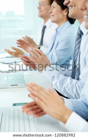 Vertical shot of applauding business people - stock photo