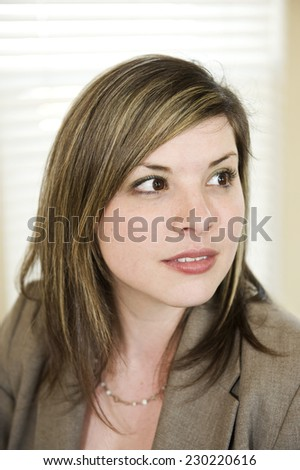 Vertical Shot Of Businesswoman Listening Carefully In Important Meeting