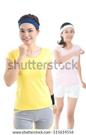 Vertical shot of cheerful female joggers keeping fit - stock photo