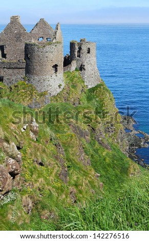 Vertical shot of Dunluce castle on the cliffs . Northern Ireland - stock photo