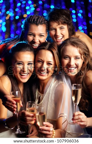 Vertical shot of group of young women having fun at wedding party - stock photo