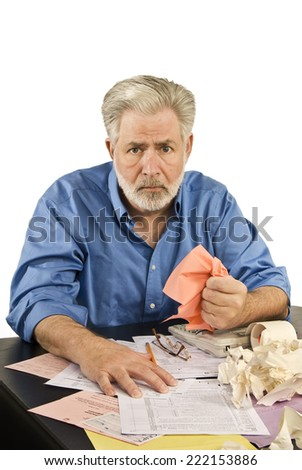 Vertical Shot Of Man Hating Doing Taxes/ Hate Doing Taxes - stock photo