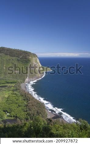 Vertical shot of Waipio coast on the Big Island of Hawaii - stock photo