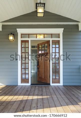 Vertical shot wooden front door upscale stock photo for Outside door with window that opens