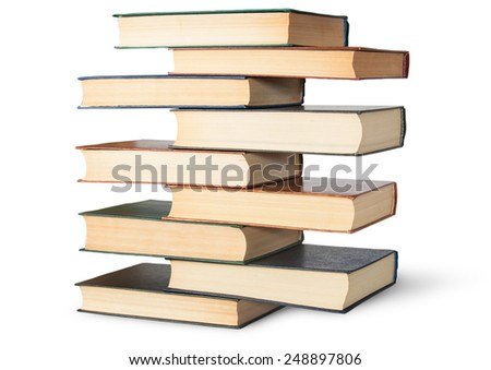 Vertical stack in old books rotated isolated on white background - stock photo