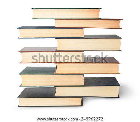 Vertical stack in old books top view isolated on white background - stock photo