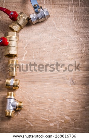 Vertical Version Organized Copyspace Aerial View Of Group Plumbing Items Brass Pipe Connectors On Wooden Board  - stock photo