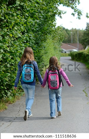 Vertical view for children on the way to school - stock photo