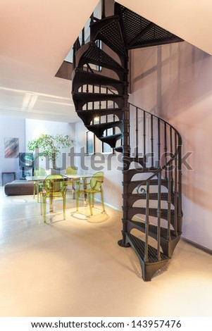 Vertical view of a metal dark spiral staircase - stock photo