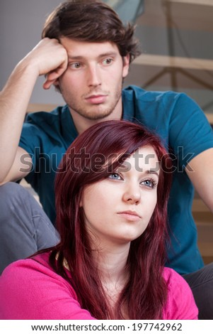 Vertical view of a thoughtful marriage at home - stock photo
