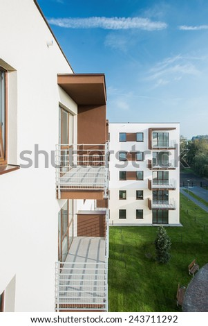 Vertical view of balconies in new block of flats - stock photo
