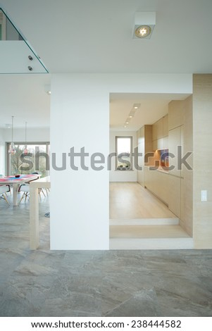 Vertical view of bright and spacious contemporary interior - stock photo