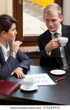 Vertical view of business partners during meeting - stock photo