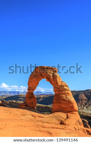 Vertical view of Delicate Arch at sunset, USA - stock photo
