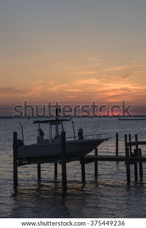 Vertical view of dock and boat with copy space