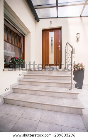 Vertical view of entrance to detached house - stock photo