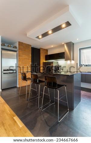 Vertical view of kitchen island in modern interior - stock photo