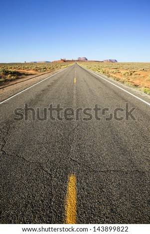 vertical view of long american road to monument valley, USA - stock photo