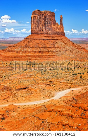 Vertical view of Monument Valley West Thumb with road - stock photo
