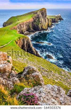 Vertical view of Neist Point lighthouse and rocky ocean coastline, Scotland, United Kingdom - stock photo