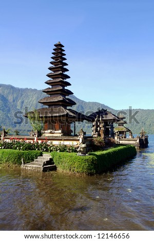 Vertical view of picturesque Balinese temple on lake in extinct volcano crater