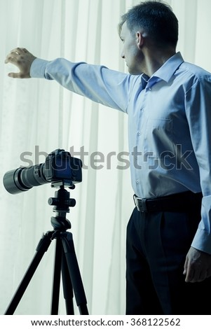 Vertical view of private detective conducting investigation - stock photo