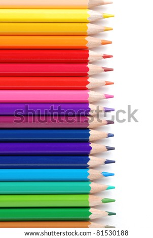 Vertical view of row of colored pencils, isolated on a white background - stock photo