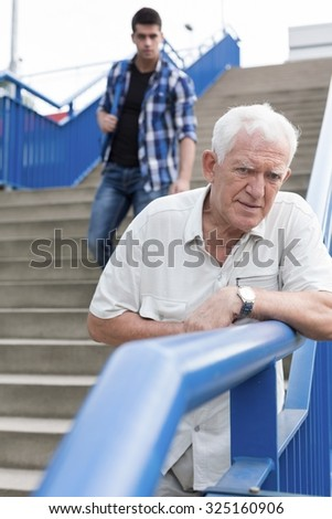 Vertical view of senior man feeling bad - stock photo