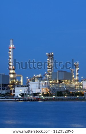 Vertical view  petrochemical oil refinery factory pipeline at  twilight Bangkok Thailand
