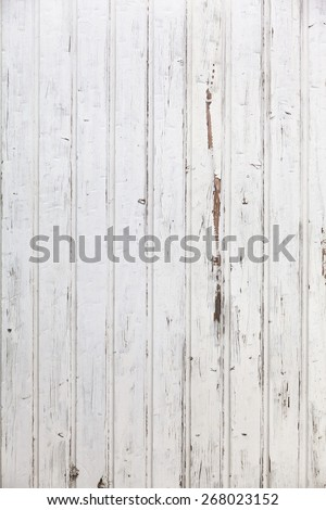 Vertical white wooden paneled shabby chic wall/White Wooden Wall - stock photo