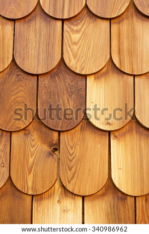 vertical wood panel made with larch shingles - stock photo