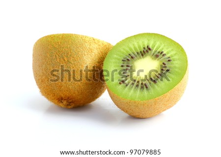 very appetizing kiwi cut in two over white - stock photo