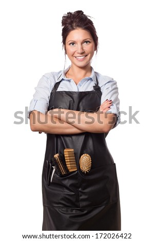 Very attractive and stylish professional hairdresser woman. In professional outfit with tools. Isolated on white.