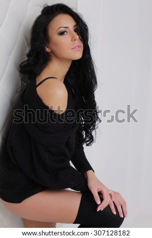 very attractive mulatto girl/woman in studio. Very long black hair. Cool body. Dark tint skin. lingerie  - stock photo