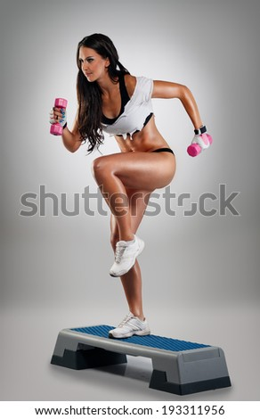 Very attractive, smiling woman doing powerstep exercise - stock photo
