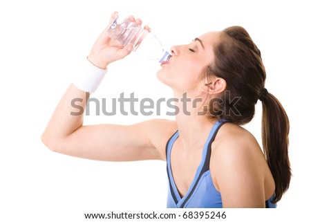 very attractive, young and fit woman drink from full bottle of water, studio shoot isolated on white - stock photo
